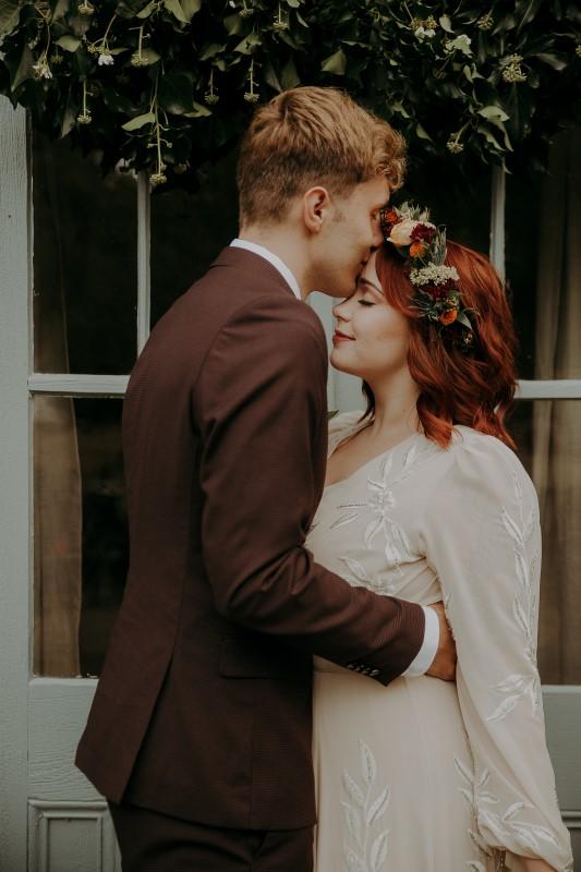 Newlyweds in front of anitique door at Bilston Creek Farm LumiPhoto