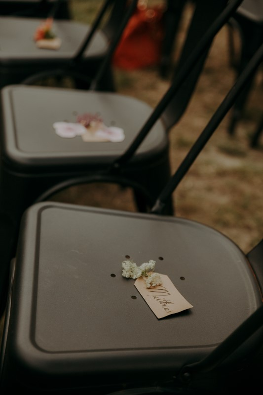 Charming Farm Wedding seats with name cards attached to flowers at Bilston Creek Farm