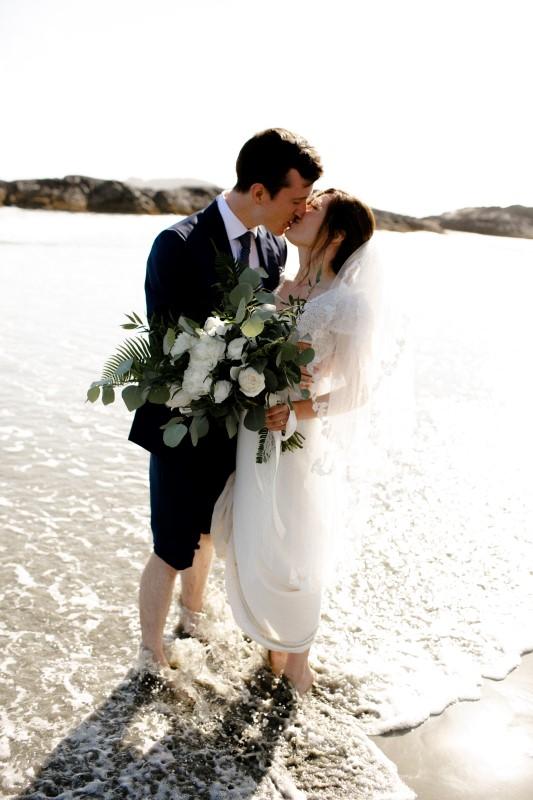 Wedding Couple Kiss on Wickaninnish Inn Beach by Sabrina Patrice Photography