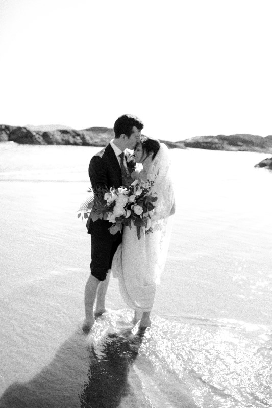 Black and White Wedding Beach Kiss Sabrina Patrice Photography