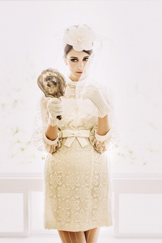 Twiggy Eyes + The Beehive Vintage Inspired Bride holding mirror dressed in lace miniskirt