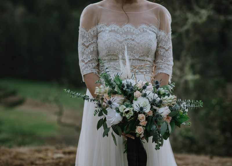 Scottish Spirit bride off the shoulder lace gown by Bliss Gowns Nanaimo and bouquet by Bespoke Blossoms