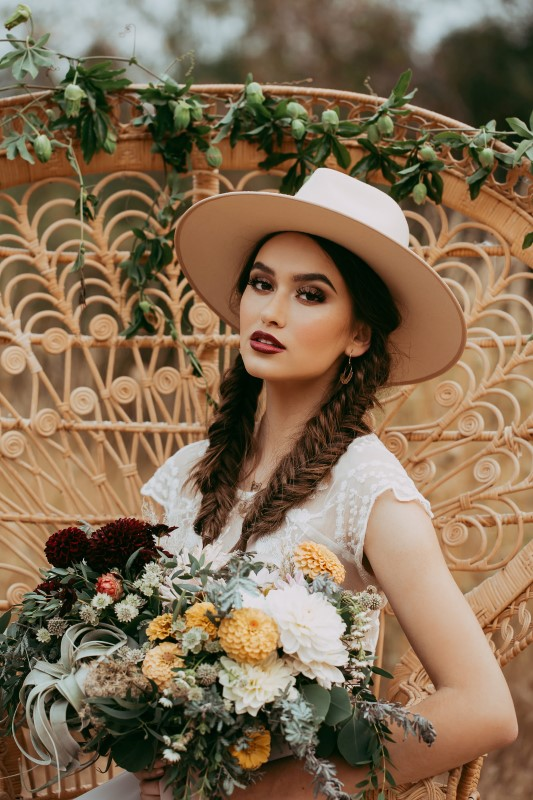 Southwest Style Bride with Hat and Colorful Bouquet Captured by Henhouse Photo Co.