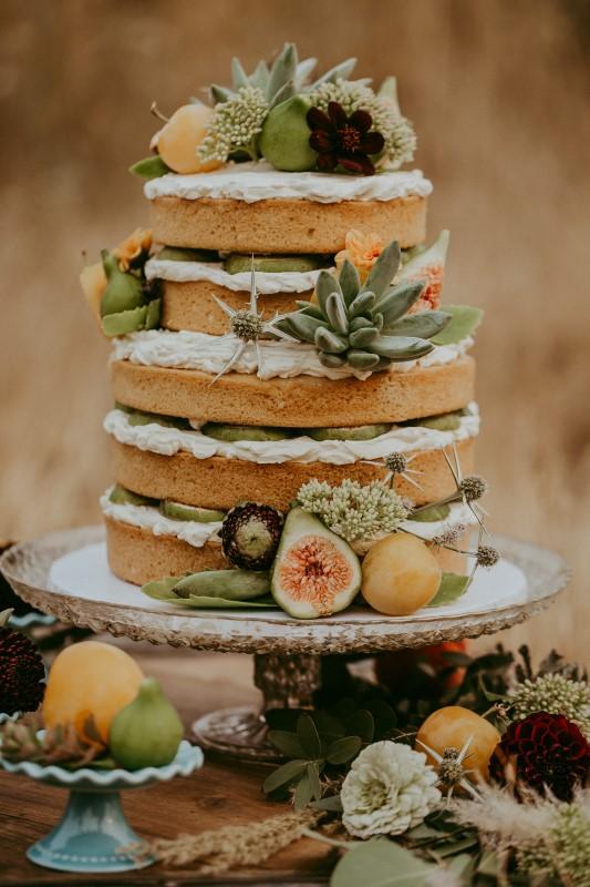 Stylish Southwest Wedding Cake With Fruit Decor by Cobble Hill Cake Co.