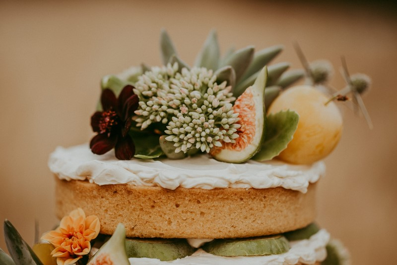Naked Wedding Cake with Fruit by Cobble Hill Cake Co.
