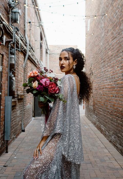 Urban Elopement Bride Holds Bouquet by En Vied Events