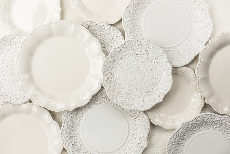 White plates artistically placed for wedding