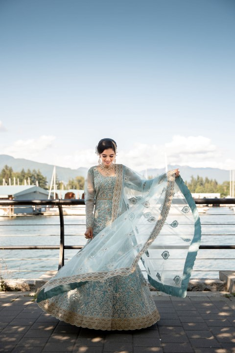 Indian Bride twirls the skirt of her sari in front of Vancouver waterfront