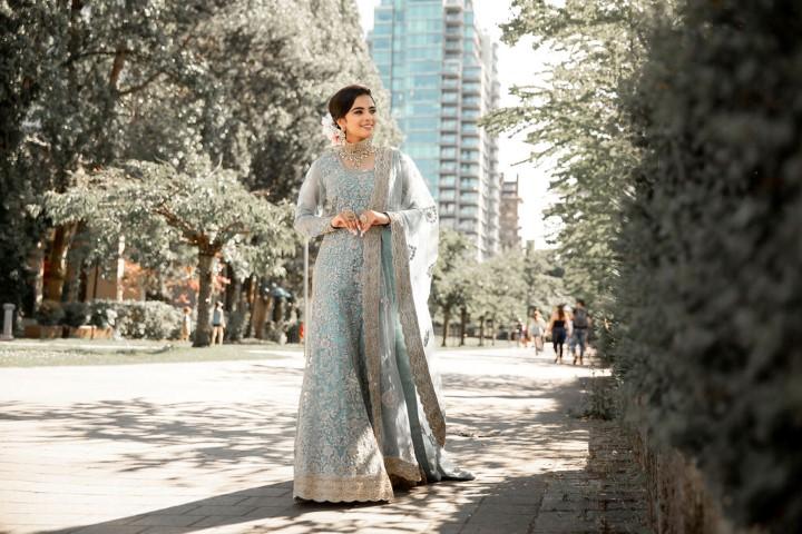Stylish Wedding at Westin Bayshore bride walks along path in Vancouver