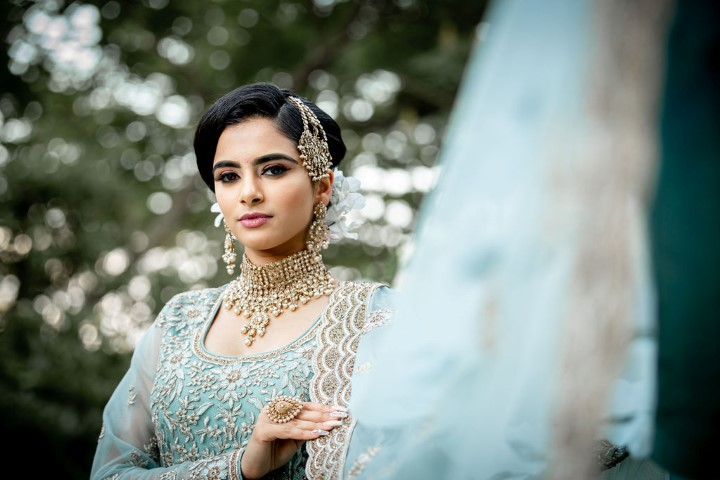 Bride in ice blue and white lace sari by Diamonds Edge Photography