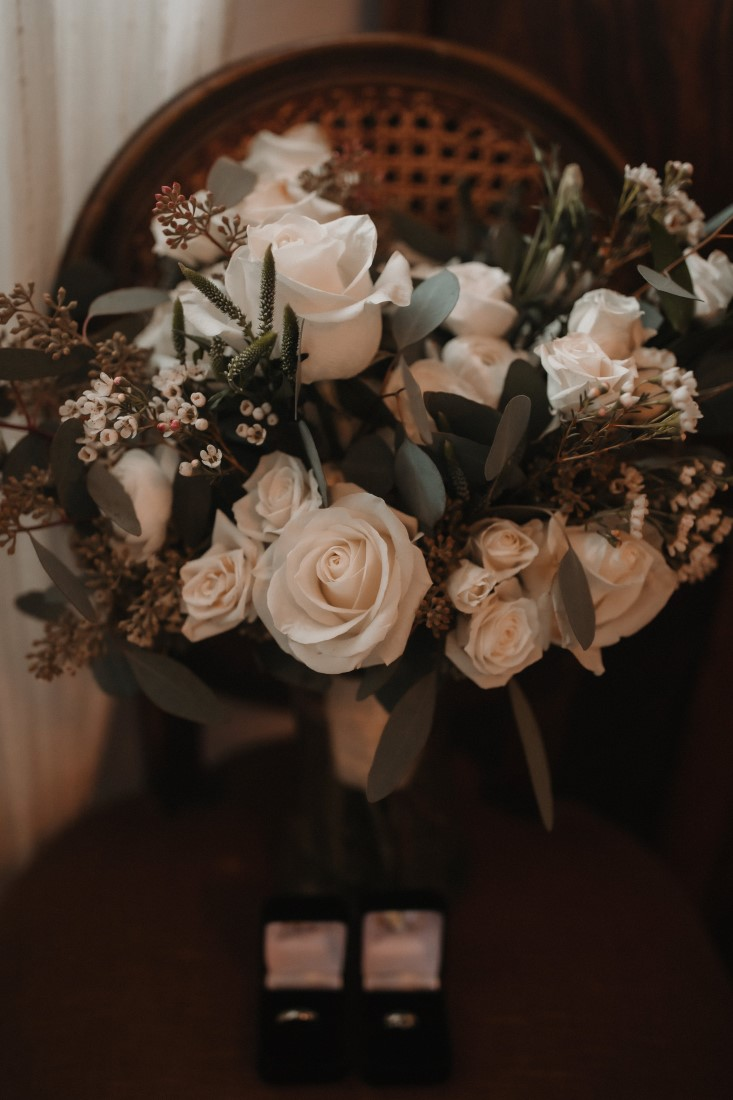 Bouquet of white roses and eucalyptus by Coastal Weddings and Events
