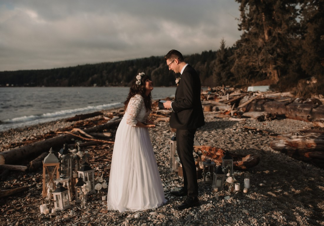 Sunshine Coast Elopement couple exchange vows in front of ocean view