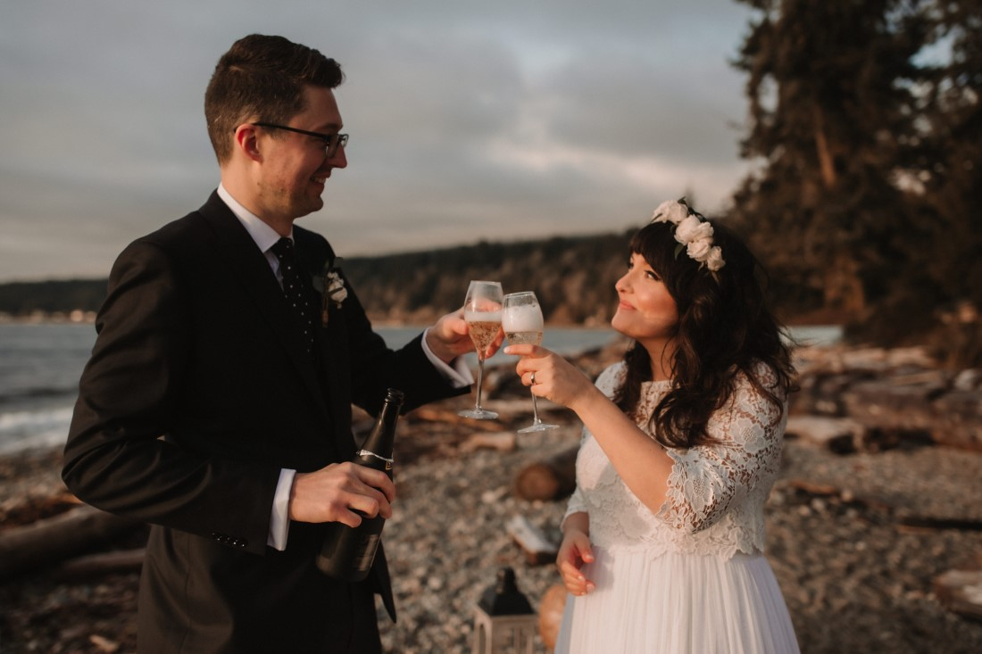Sunshine Coast Elopement couple toast with champagne after wedding ceremony on the beach