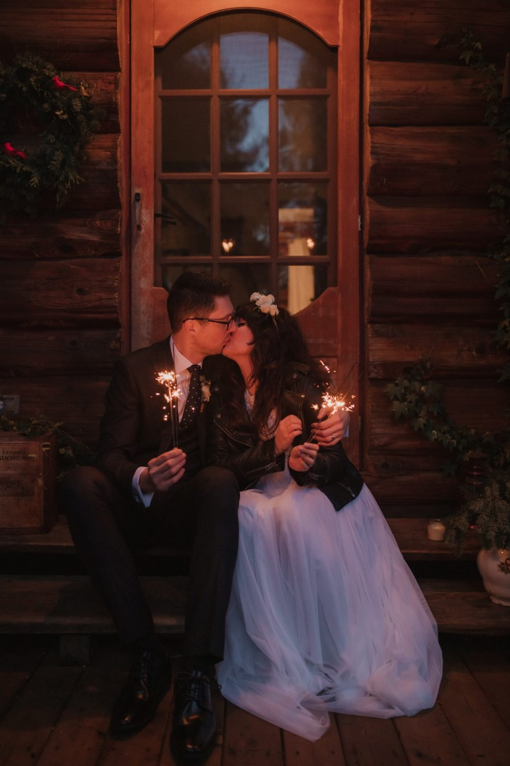 Sunshine Coast Elopement couple sits on the steps of cabin in Giibson