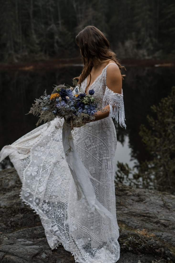Bride in lace reclaimed gown with off the shoulder ruffle and bouquet