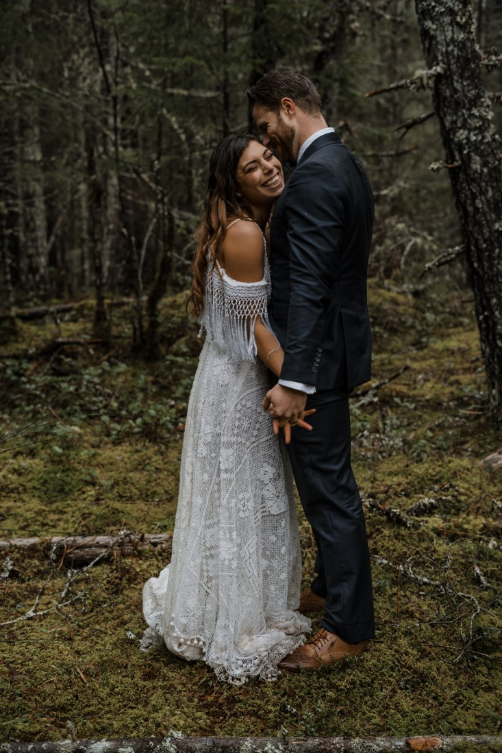 Bride and Groom embrace at Spectacle Lake Eva Cherneff collective