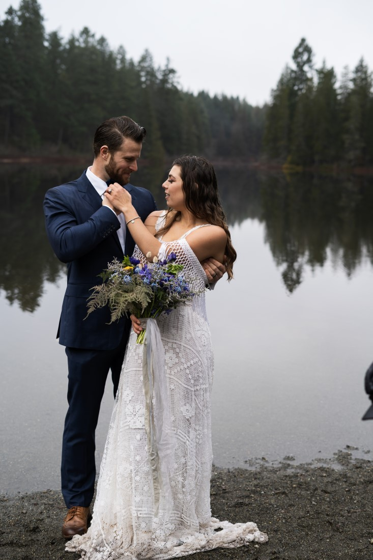 Eloping couple by lake by Brittany Carey Photography