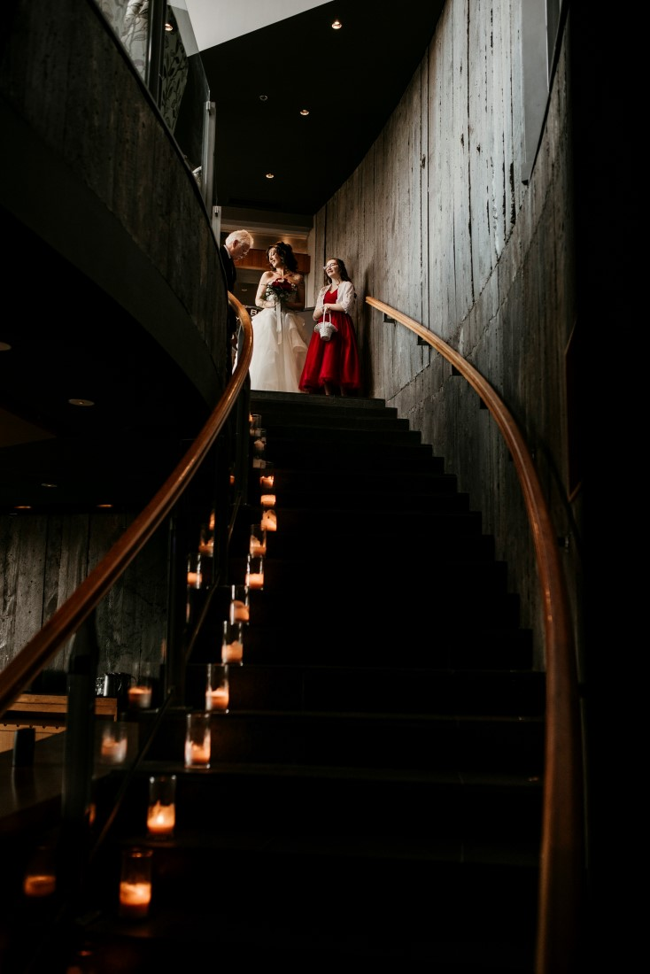 Bride waits to walk down candlelit staircase to Wine Cellar at Black Rock Oceanfront Resort