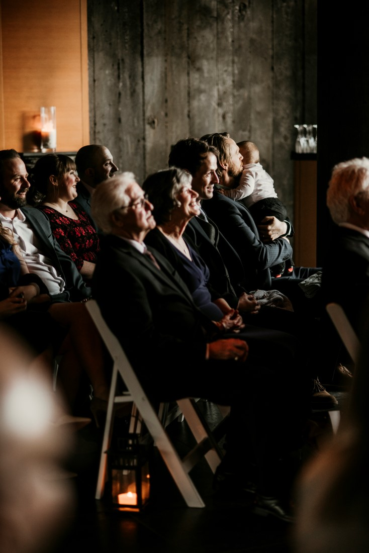 Wedding Guests watch ceremony raptly by Jen McLeod Photography