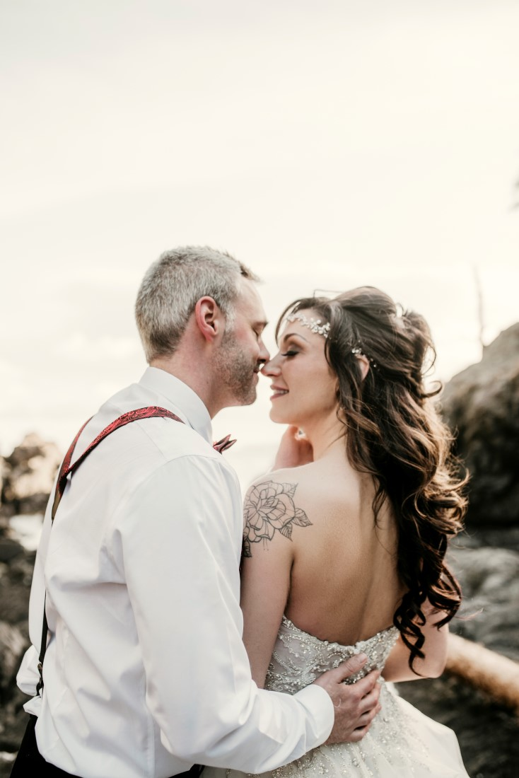 Bride and Groom on oceanfront in Ucluelet by Jen McLeod Photography