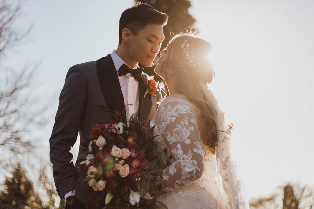 Sun kissed newlyweds kiss along Vancouver waterfront by Kacie McColm Photography