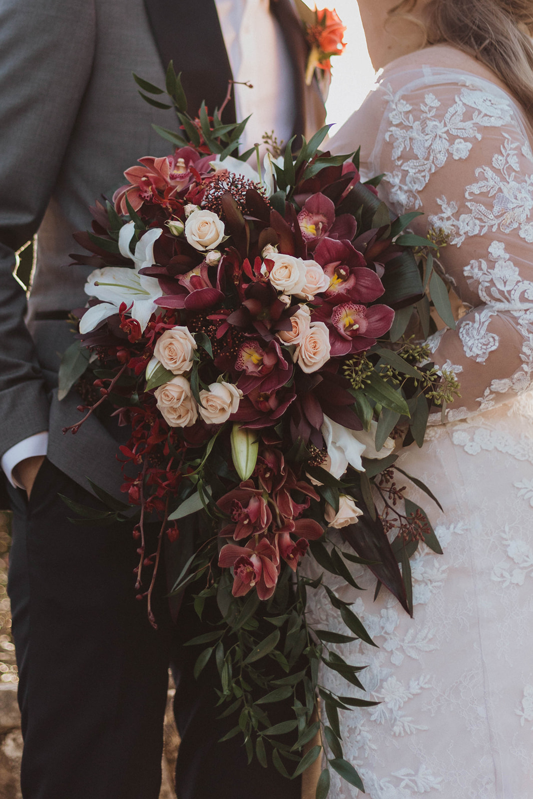Bridal bouquet of burgundy roses, calla lillies and eucalyptus by Niki Trading in Vancouver