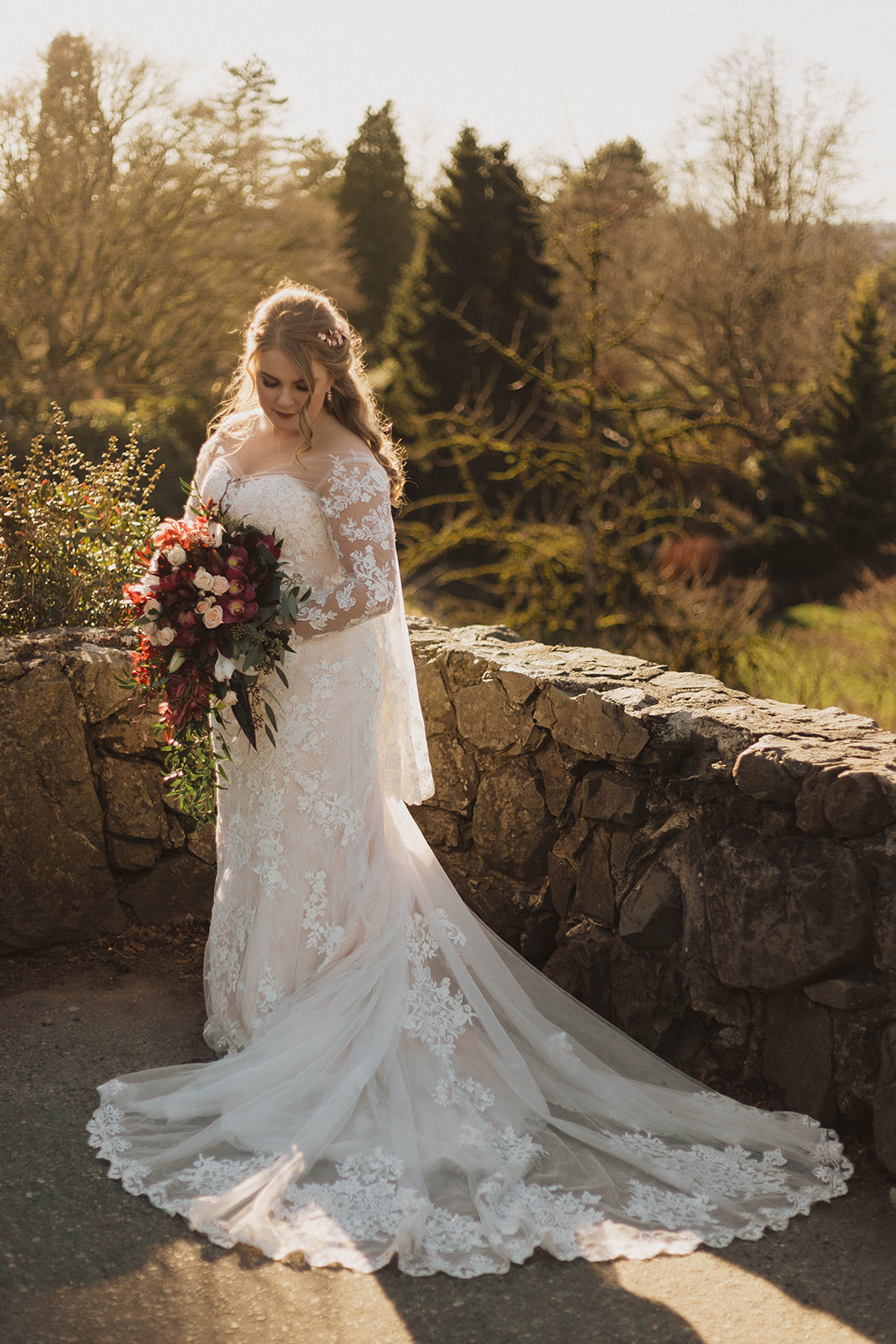 Bride with cascading bouquet and lace gown by Blush Victoria by Kacie McColm PHotography