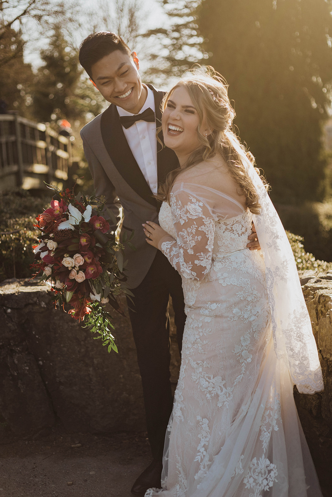 Newlyweds laughing as they take photos after ceremony in Vancouver by Kacie McColm