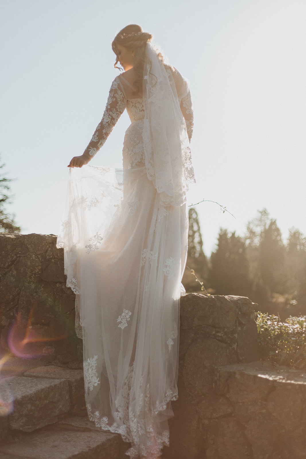 Bride with lace gown and train by Blush Victoria