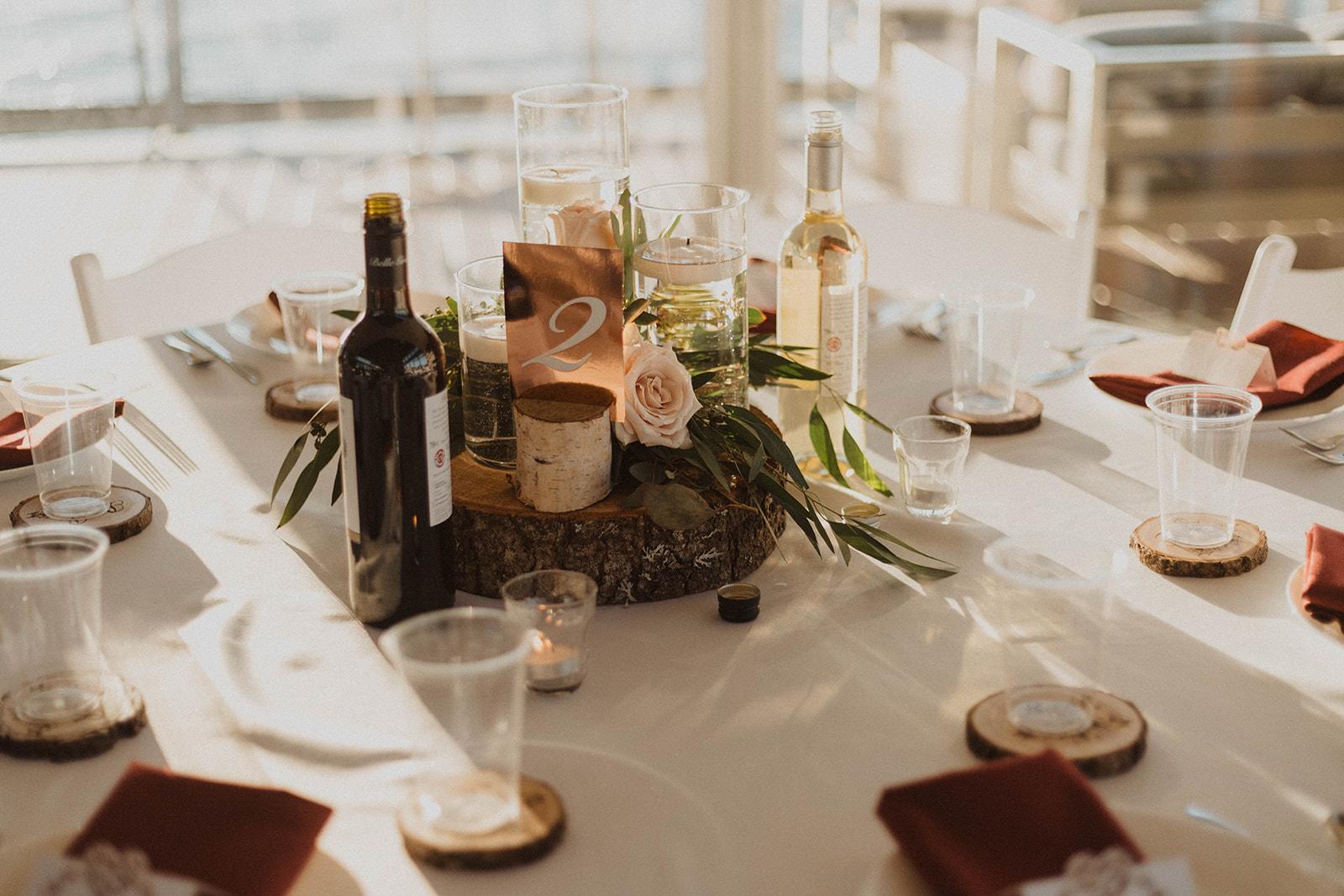 UBC Boathouse table decor floating candle with blush pink roses and eucalyptus by West Coast Weddings Magazine