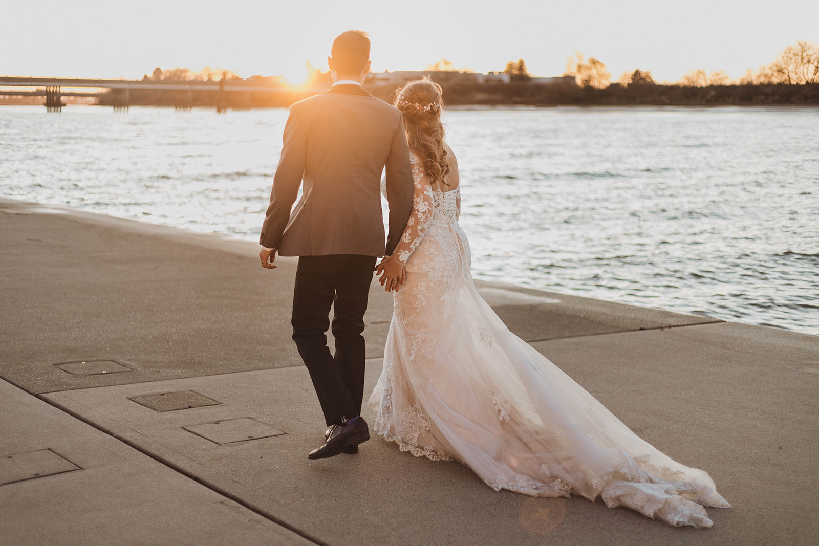 UBC Boathouse Wedding Couple Ruby and Roy walk along the Vancouver water edge