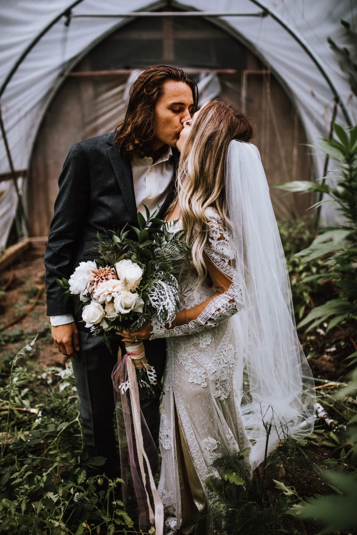 Newlyweds kiss by Wild Oak Collective