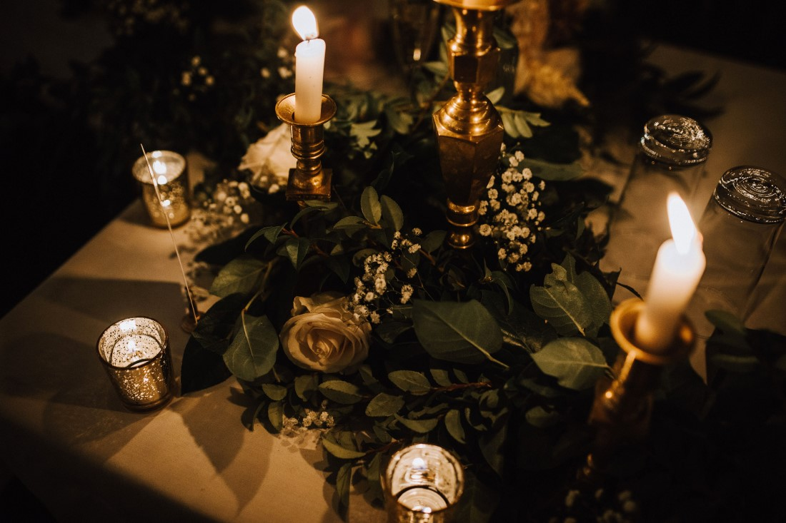 Gold tea candles and floral decor on wedding reception table by Trend Decor Vancouver Island