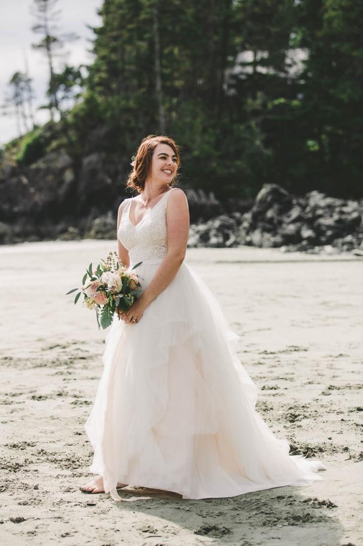 Ocean Wedding bride with bouquet on Tofino beach wearing David's Bridal