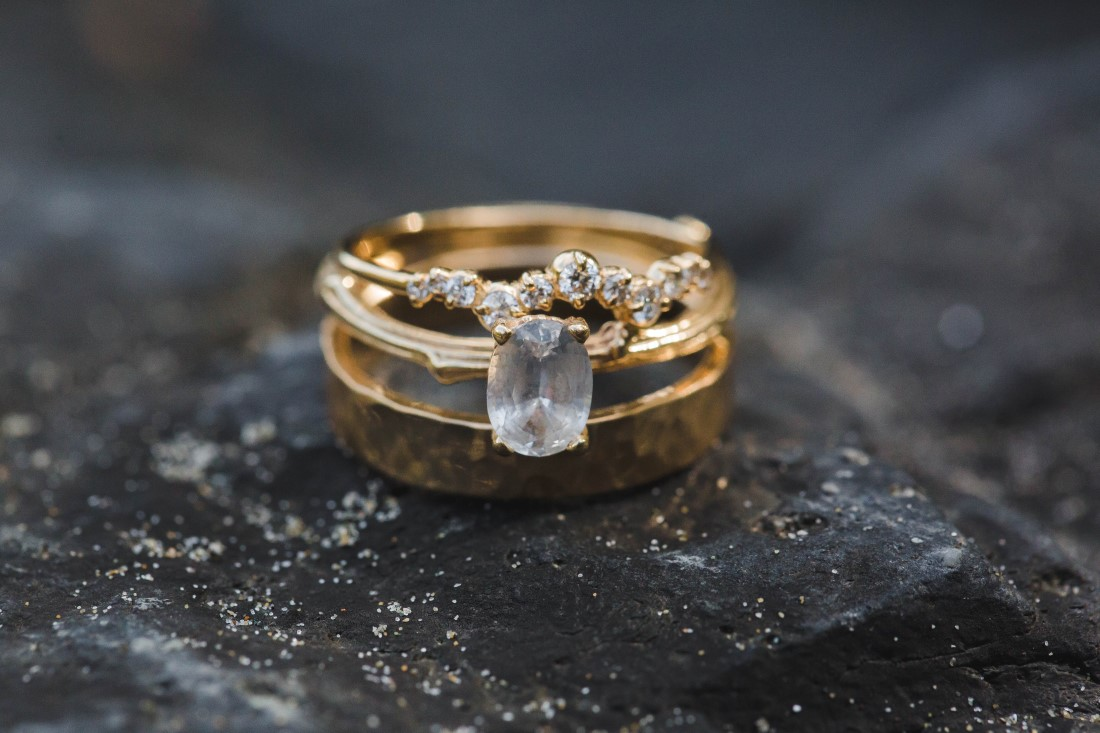 Diamond Rings sitting on rock at Tofino beach by Michelle Milward Photography