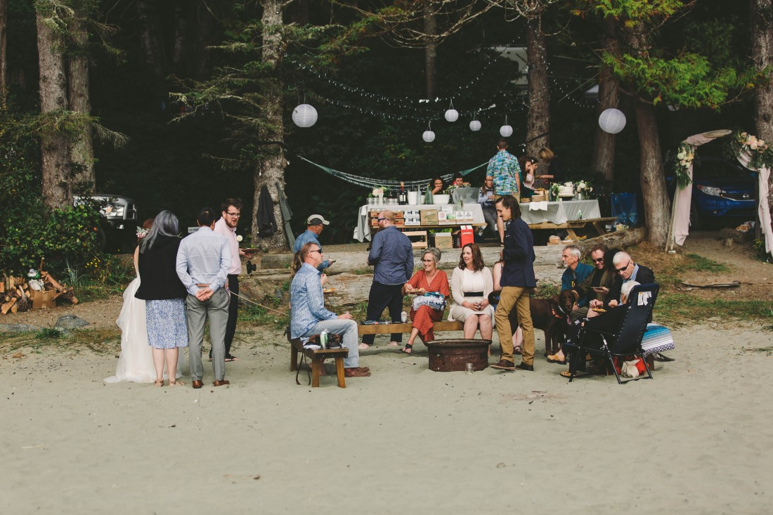Ocean Wedding Reception Guests enjoy beer and pizza on Tofino beach