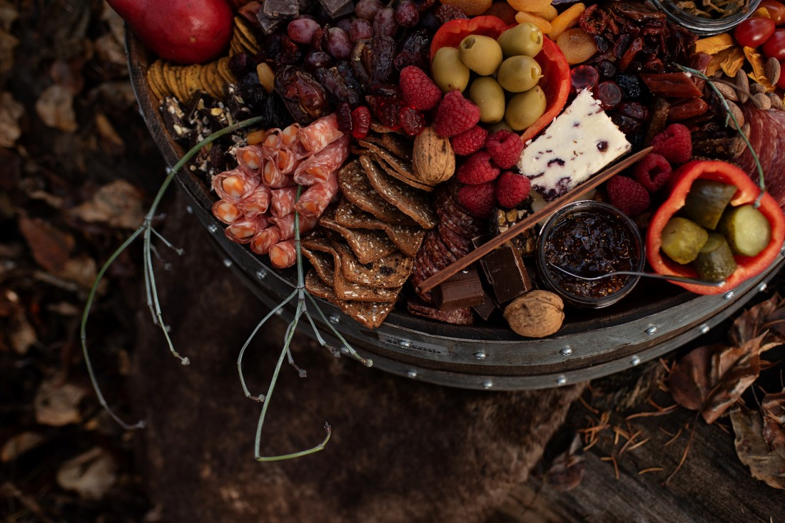Charcuterie with pine cones for wedding reception table by The Charcuterie Bear Vancouver
