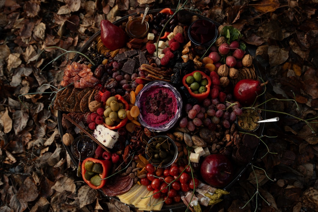 Charcuterie board in rich autumn colors and fruit by The Charcuterie Bear Vancouver