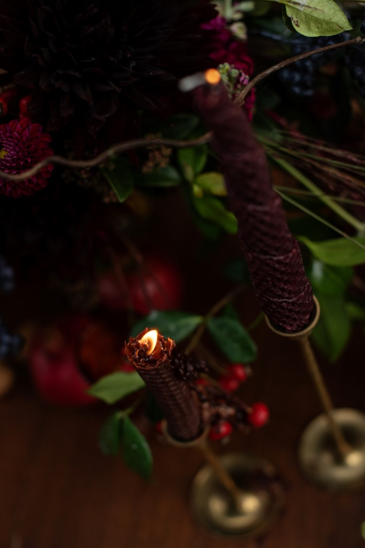 Burgundy beeswax tape candle and gold candlesticks by Thistle and Thorne Weddings