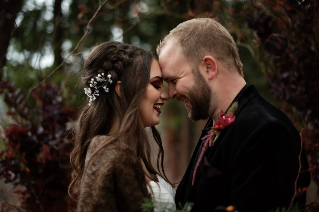 Bride with crown braids and flowers in her hair by Vancouver Makeup