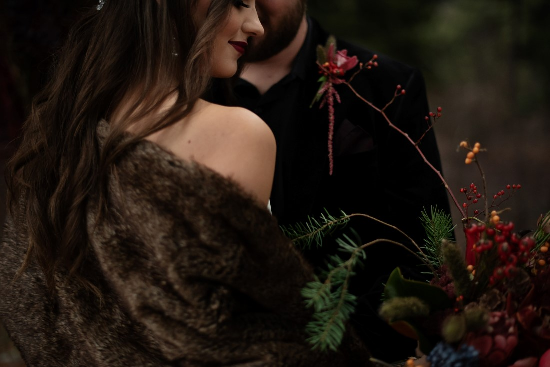 Bride wearing brown stole over white wedding gown by The Dressy Attic Vancouver