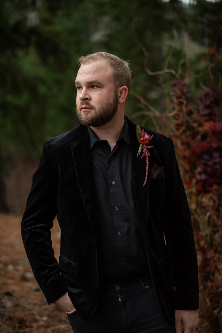 Groom in black velvet jacket and black shirt with boutonniere by Cardero Clothing Vancouver