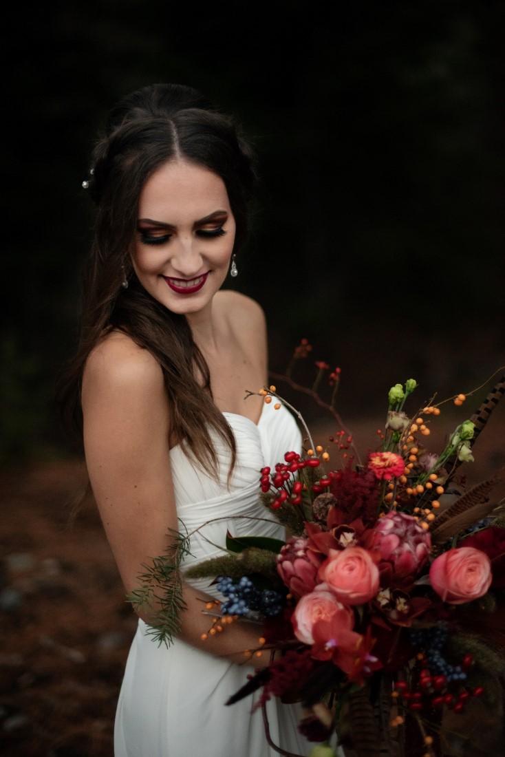 Bride carrie bouquet of deep rose flowers with protea by Deborah Lee Designs