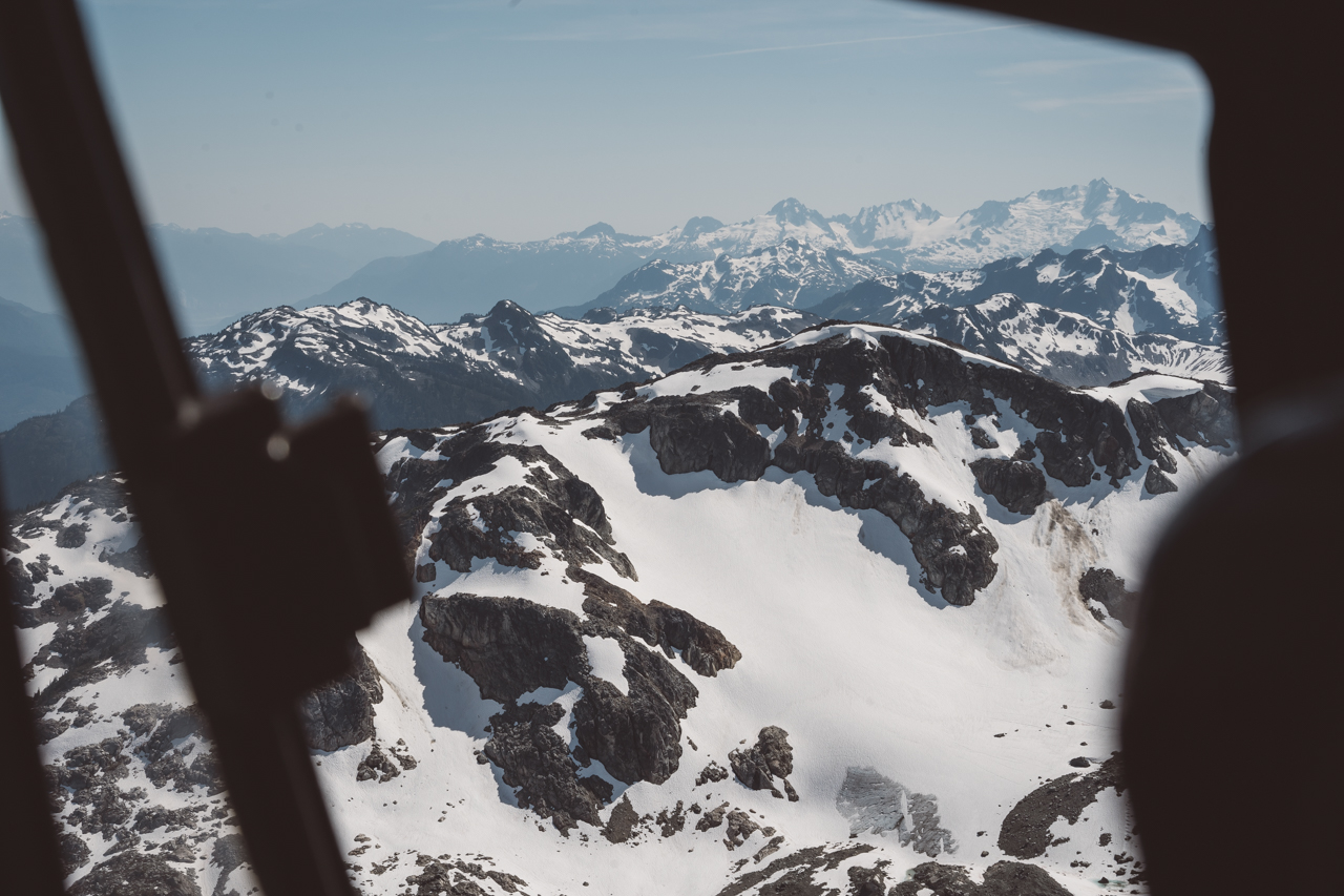 Bride and Groom look out window of Blackcomb helicopter