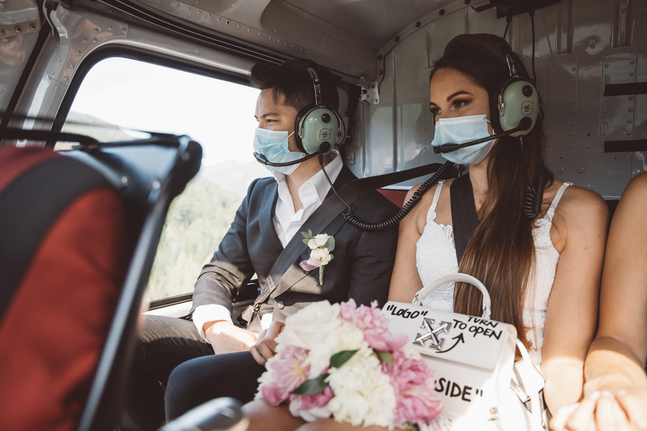 Couple in Blackcomb Helicopter wear masks while flying to wedding ceremony