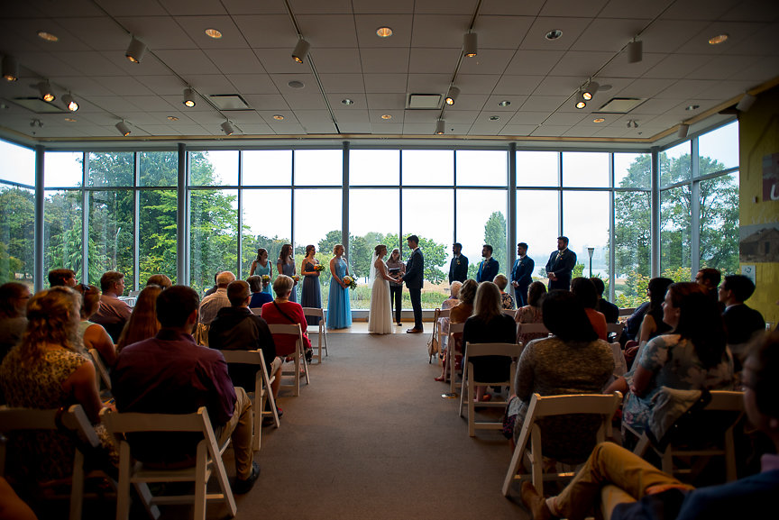Vancouver Museum wedding ceremony in front of bank of windows