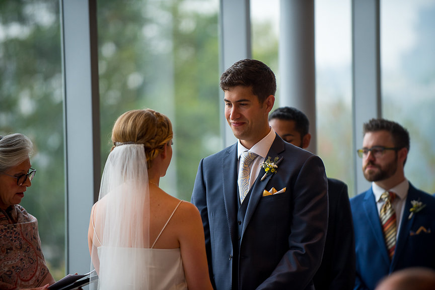 Wedding Couple exchange vows at Museum of Vancouver