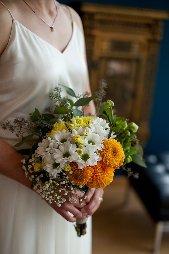 Bridal bouquet of white, yellow and orange gerbera daisies