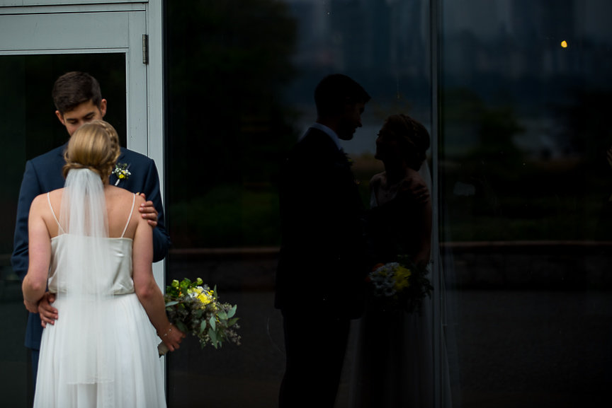 Wedding Couple reflection in the glass at Vancouver Art Museum
