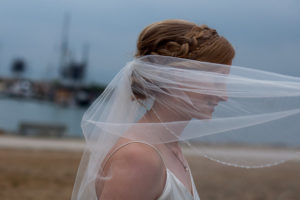 Bride with veil over her face by Everly Fine Bridal Vancouver